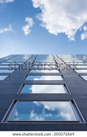 Clouds reflecting in the window of a business building in Darmstadt, Germany