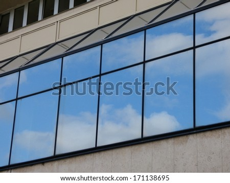 Clouds reflecting in windows