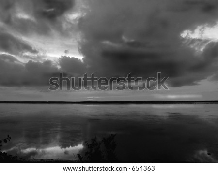 Clouds reflections in black and white on Nova Scotia coastline, Canada   - natural grain