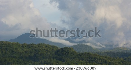 Clouds rolling in over high mountains on Panay island in the Philippines
