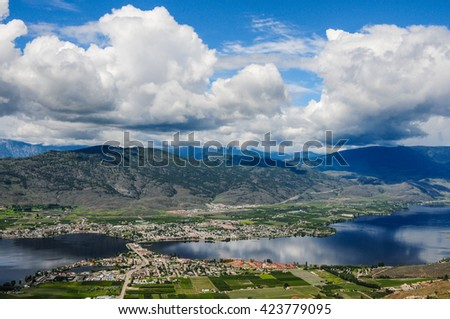 Clouds rolling over the town and lake Osoyoos, Southern British Columbia, Canada - stock photo