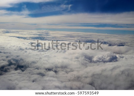 clouds seen from an airplane blue background nature sunshine