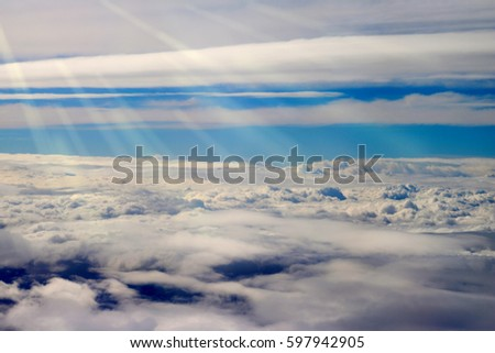 clouds seen from an airplane, blue sky sunshine, amazing background
