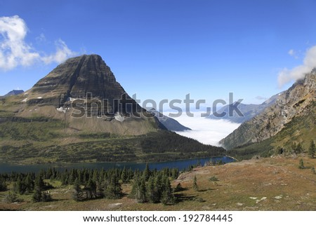 Clouds Settle in the Valley Near Hidden Lake Trail, Glacier National Park, Montana - stock photo