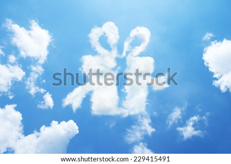 Clouds shaped like a gift. - stock photo