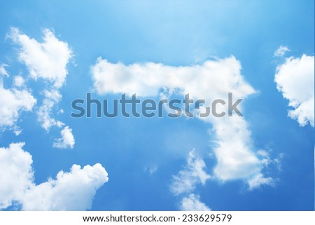 Clouds shaped like a handgun. - stock photo