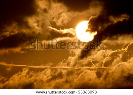 Clouds' silhouette with the sun setting behind.