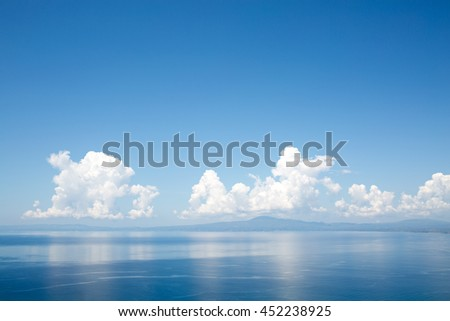Clouds sky reflected in sea