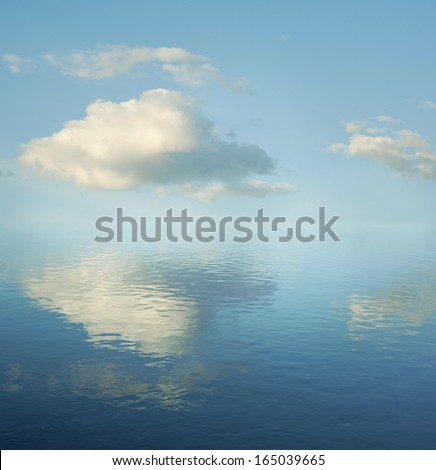 Clouds. Sky. Reflection. Water. - stock photo