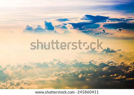 Clouds. sky with clouds at sunset or sunrise. above from airplane over the ocean. - stock photo