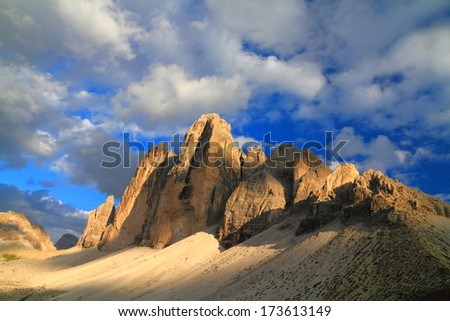 Clouds throwing shades on Tre Cime di Lavaredo, Dolomite Alps, Italy