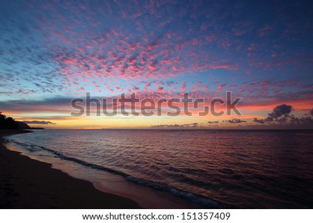 Clouds turning pink at sunset on the North Shore, Oahu - stock photo