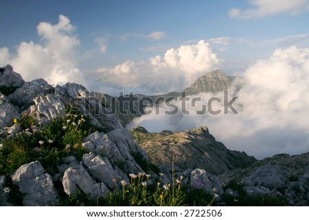 clouds under mountains - stock photo