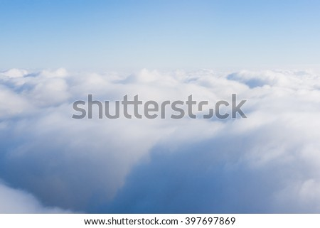 Clouds. view from the window of an airplane. cloudscape scenery with blue sky above - stock photo