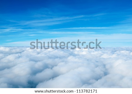 clouds. view from the window of an airplane flying in the clouds - stock photo