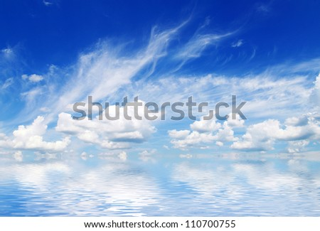 clouds with rainbow in the blue sky - stock photo