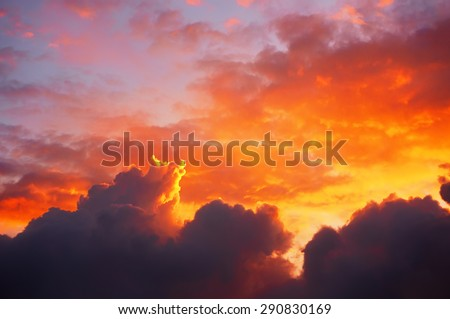 cloudscape at sunset with dramatic red clouds - stock photo