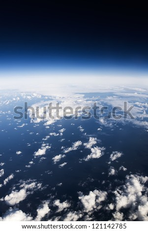 Cloudscape. Blue sky and white cloud. Sea and coastline