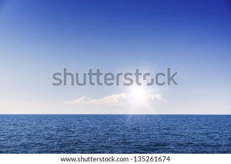 Cloudscape. Blue sky and white cloud. Sea and skyline
