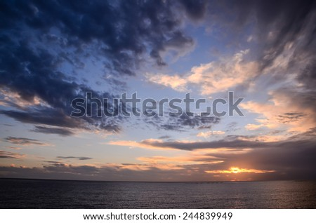 Cloudscape, Colored Clouds at Sunset near the Ocean - stock photo