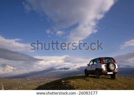cloudscape for one vehicle off-road - stock photo