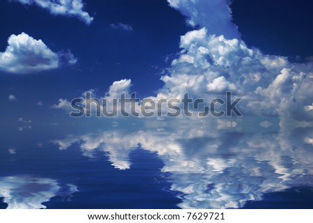 Cloudscape mirroring in water - nature abstract background - stock photo
