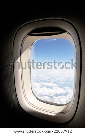cloudscape of window at flying airplane - stock photo