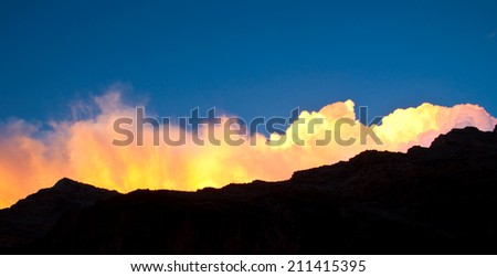 Cloudscape over a rim of Grand Canyon National Park. - stock photo
