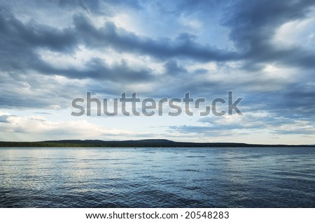 Cloudscape over Green Lake, Canada - stock photo