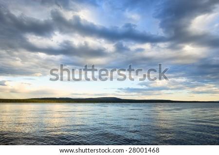 Cloudscape over Green Lake, Canada - stock photo