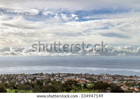 Cloudscape over Pacific ocean and horizon near the city of La Jolla a suburb of San Diego, California. Late afternoon aerial view of thick clouds over the water.  - stock photo