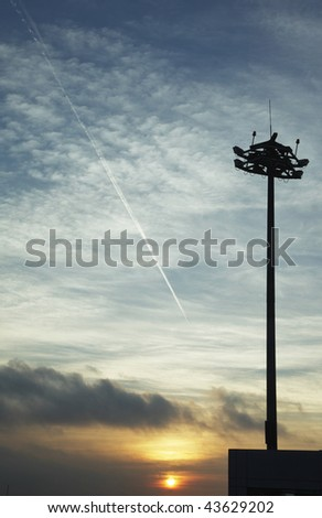cloudscape with a flying airplane - stock photo