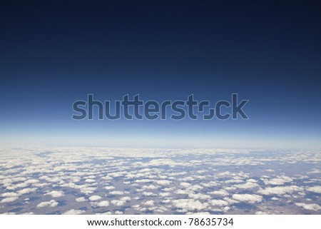 Cloudscape with deep blue atmosphere 40,000 above planet earth. - stock photo