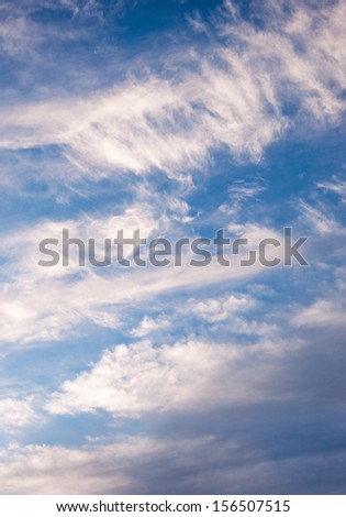 Cloudscape with puffy and whispy cloud patterns - stock photo