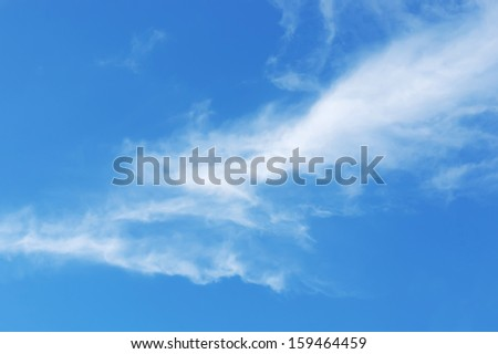 cloudscape with white fluffy clouds and blue sky