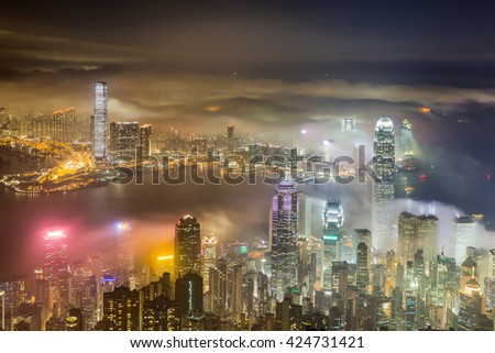 Cloudy and foggy Hong Kong at night - stock photo