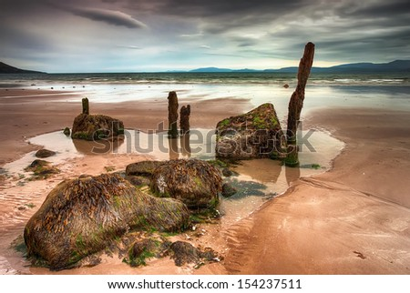 Cloudy beach in Ireland. - stock photo