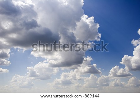 Cloudy blue sky taken at sea level low horizon with 18mm lens - stock photo