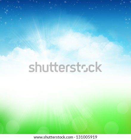 Cloudy blue sky with stars and green field abstract background - stock photo