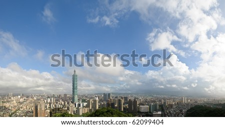 Cloudy cityscape of Taipei with famous 101 skyscraper in Taiwan. Horizontal wide panoramic city scenery. - stock photo