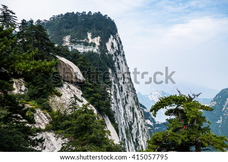 Cloudy day on Mount Hua in Shaanxi province. It is one of the five Chinese sacred mountains with very steep hills. - stock photo