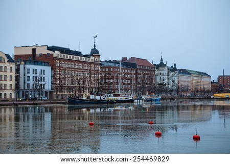 Cloudy day, the Baltic Sea and Quay Pohjoisranta in Helsinki - stock photo