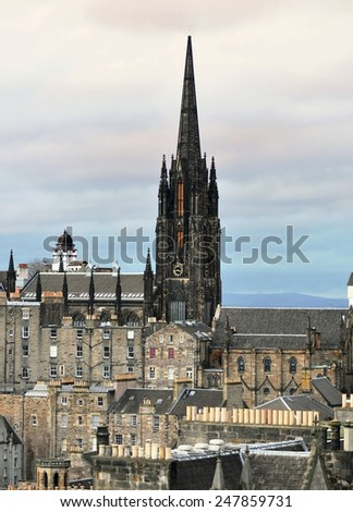 Cloudy day view of Edinburgh old town skyline and church   - stock photo