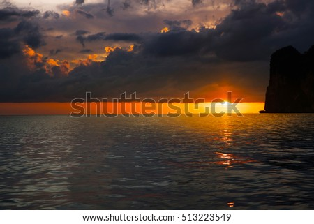 Cloudy dramatic sky over the sea sunset background