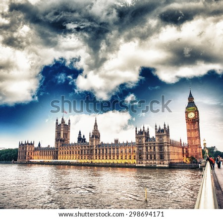 Cloudy evening over Houses of Parliament - London. - stock photo