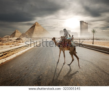 Cloudy evening over the road to pyramids - stock photo