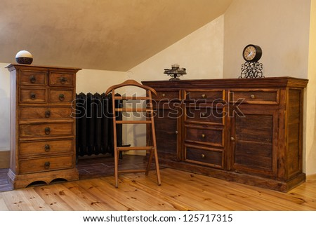 Cloudy home - brown wooden old fashioned dresser - stock photo