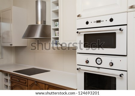 Cloudy home - closeup of white kitchen appliances