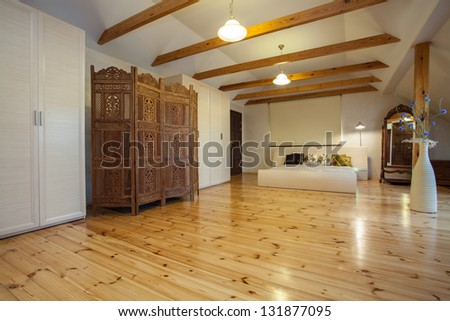 Cloudy home - wooden original screen in huge spacious bedroom - stock photo