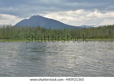 Cloudy lake landscape. Deep lake, Siberia, Russia, Peninsula Taimyr, Putorana plateau - stock photo